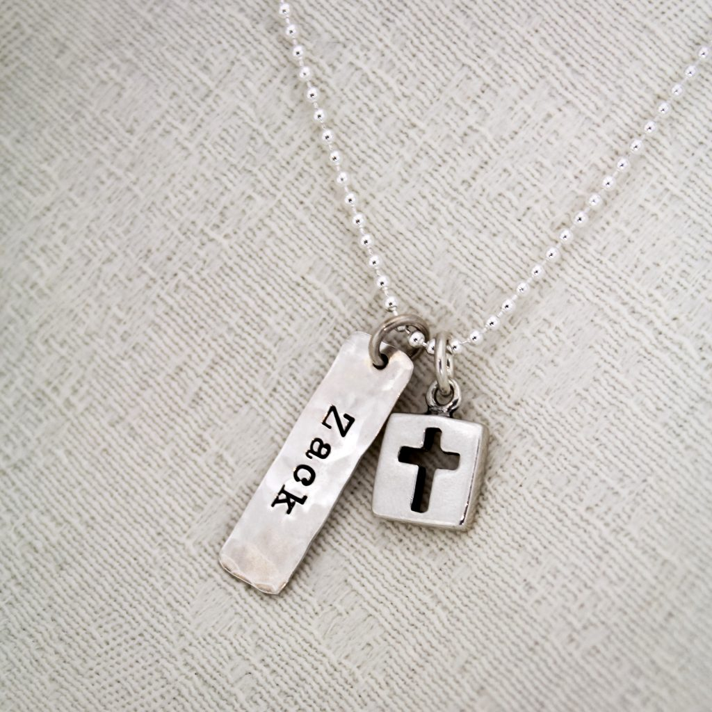 Unique and personalized silver boys confirmation necklace.