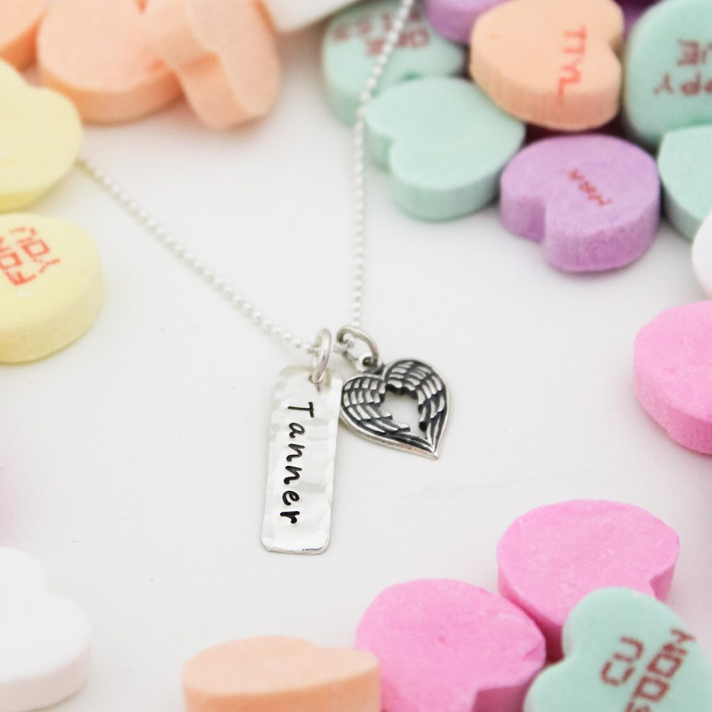 Adorable heart angel wing necklace with name tag in sterling silver.