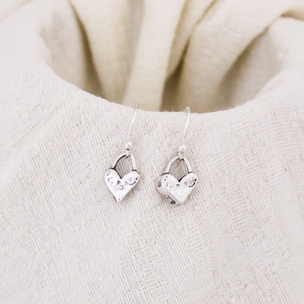 Small sterling silver heart earrings that are a perfect gift for Valentine's Day.