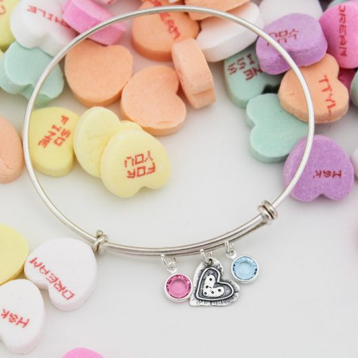 Unique rustic heart silver bangle with birthstone gem charms by Tracy Tayan Designs.