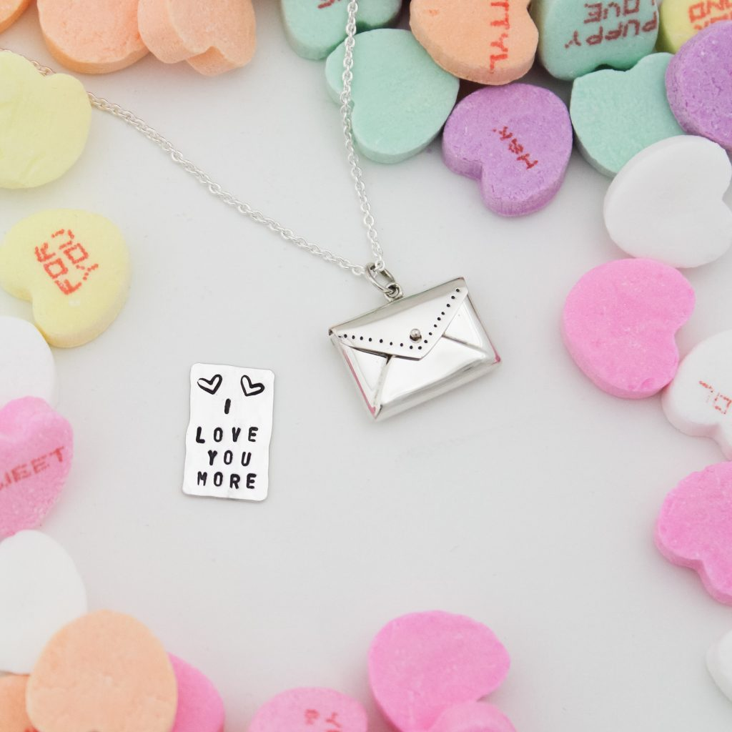Unique designs by Tracy Tayan, tiny love envelope with secret message inside.