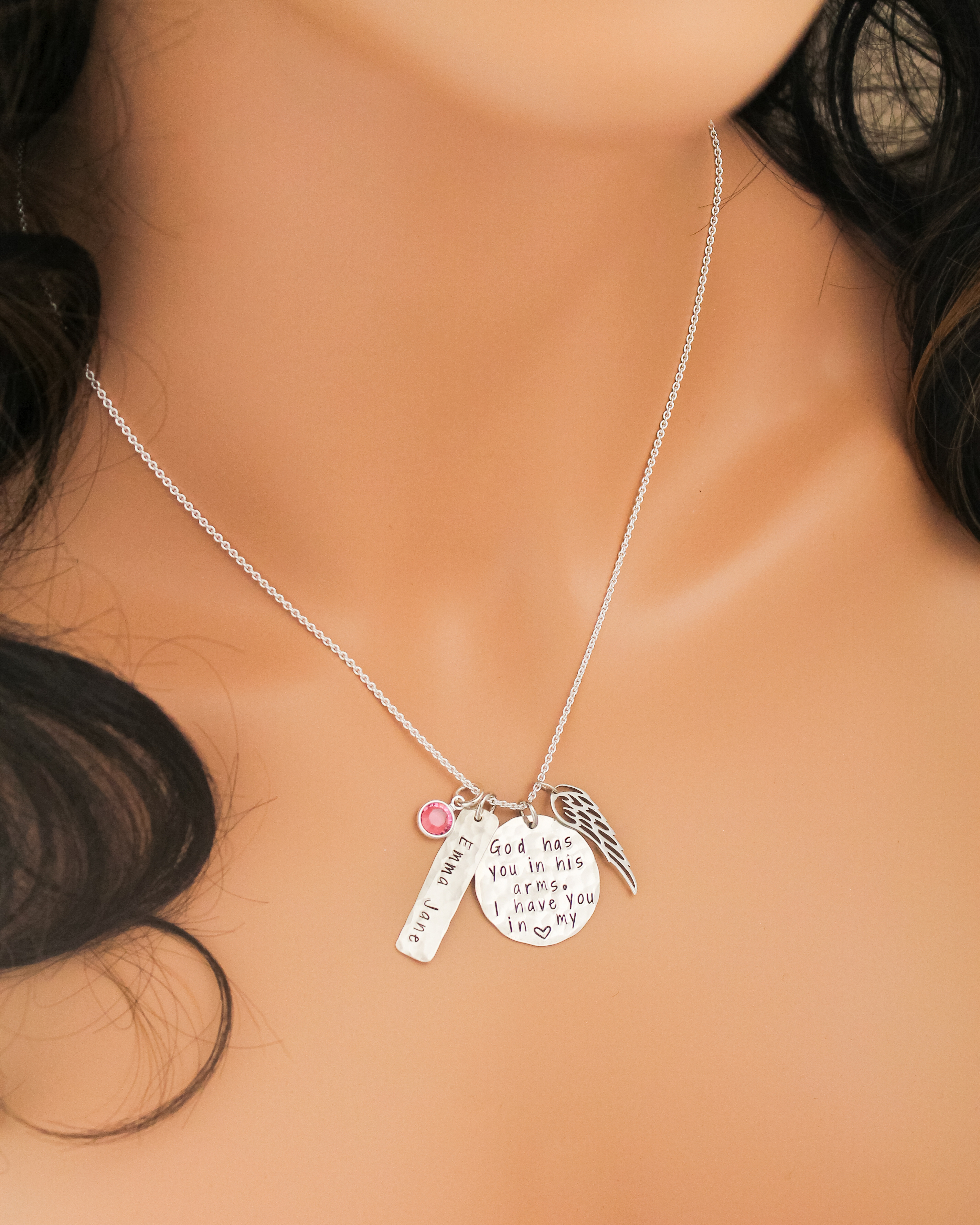 Heartfelt memorial baby necklace personalized with name and angel wing.
