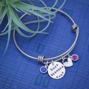 Unique grandmother bangle with small silver heart and birthstones of grandchildren.