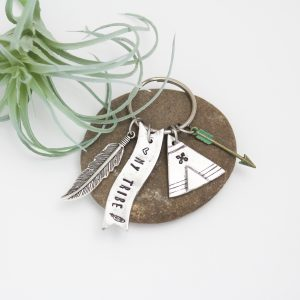 Unique pewter keychain with teepee, feather, and arrow.