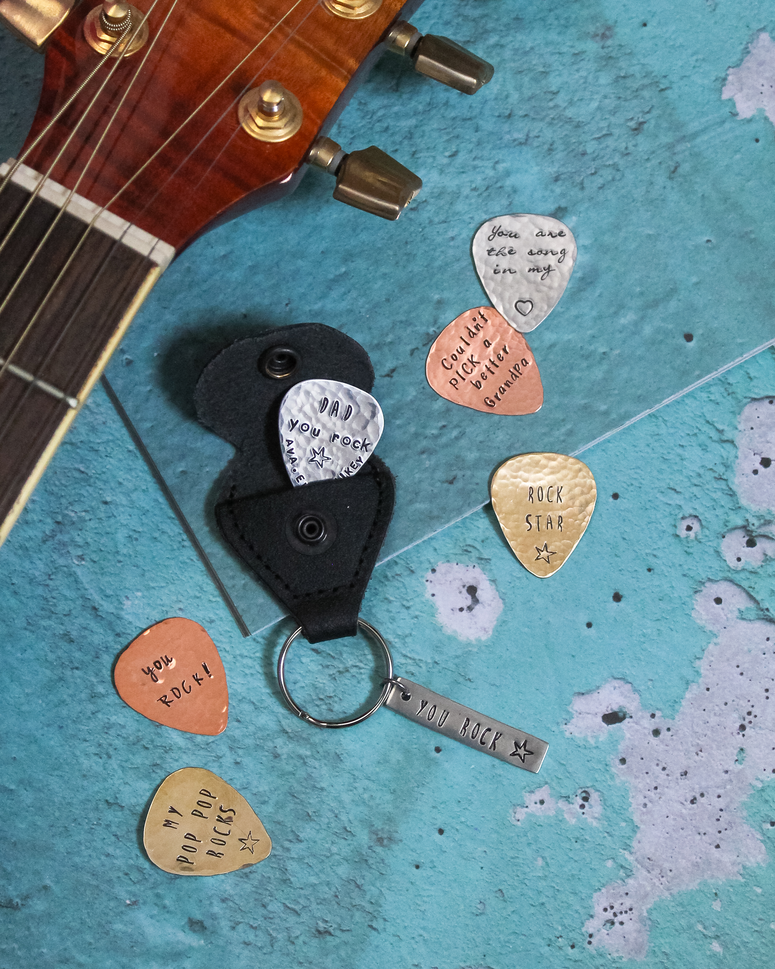 Personalized hand stamped guitar picks for father's day.