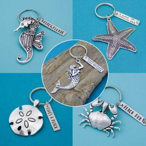 Beach keychains includes mermaid, sand-dollar, crab, seahorse, and starfish.