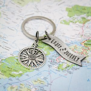 Enjoy the Journey banner keychain with compass.
