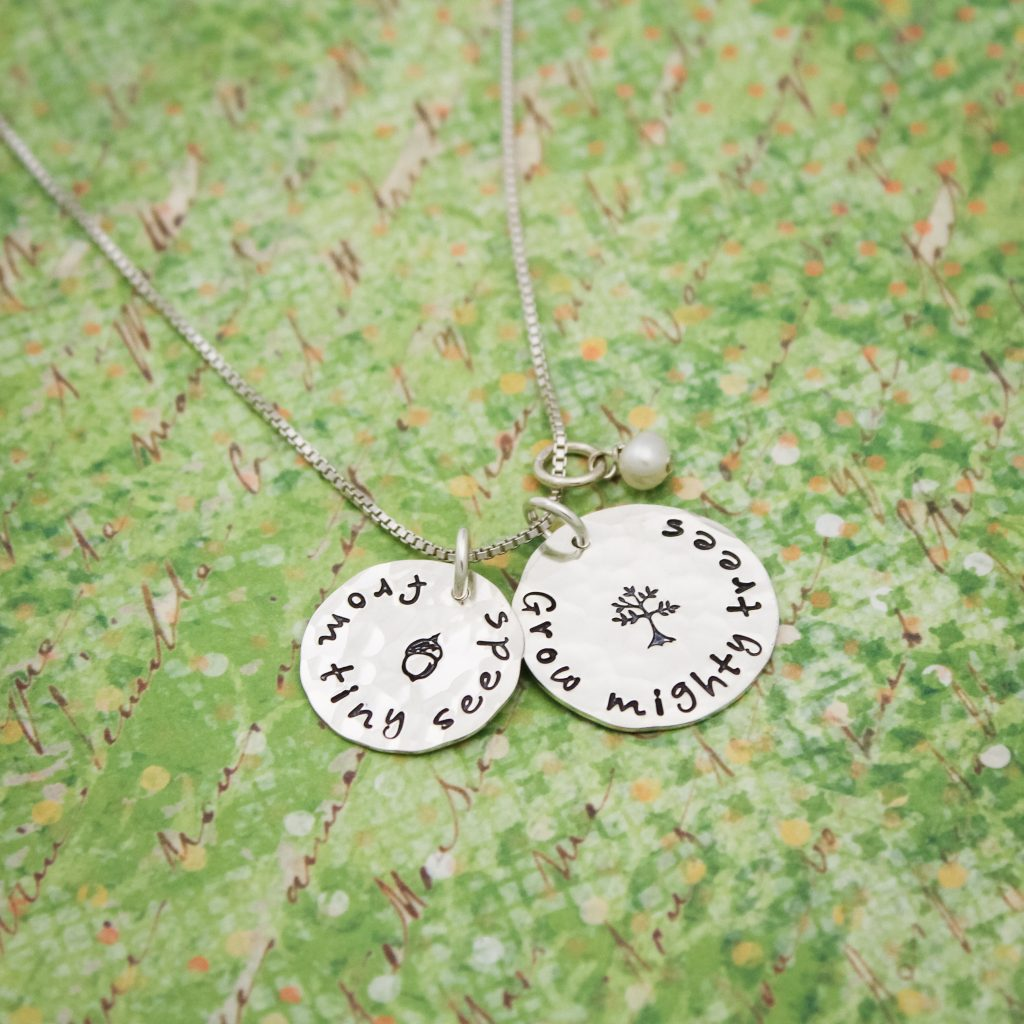 Hand stamped teacher education necklace in all silver.