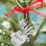 Unique personalized pineapple ornament personalized with name.