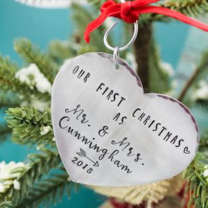 Personalized heart ornament with our first christmas and names.