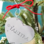 Unique personalized heart christmas ornament with child's name.