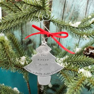 Hand stamped Christmas tree ornament with family name.
