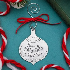 A traditional shaped pewter ornament personalized with couples name and year.