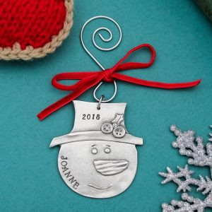 Unique rustic snowman christmas ornament personalized with name.