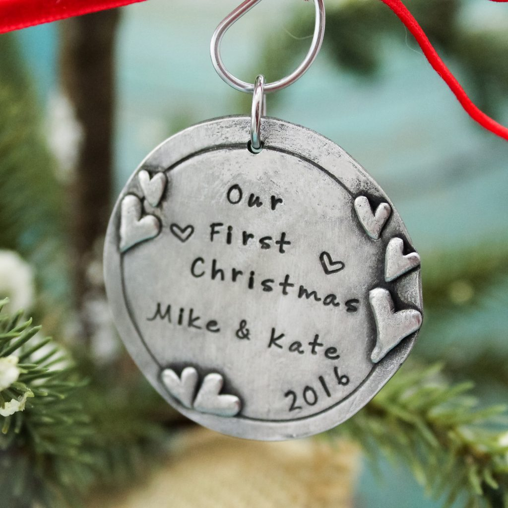 Personalized Our First Christmas Ornament personalized with couples names.