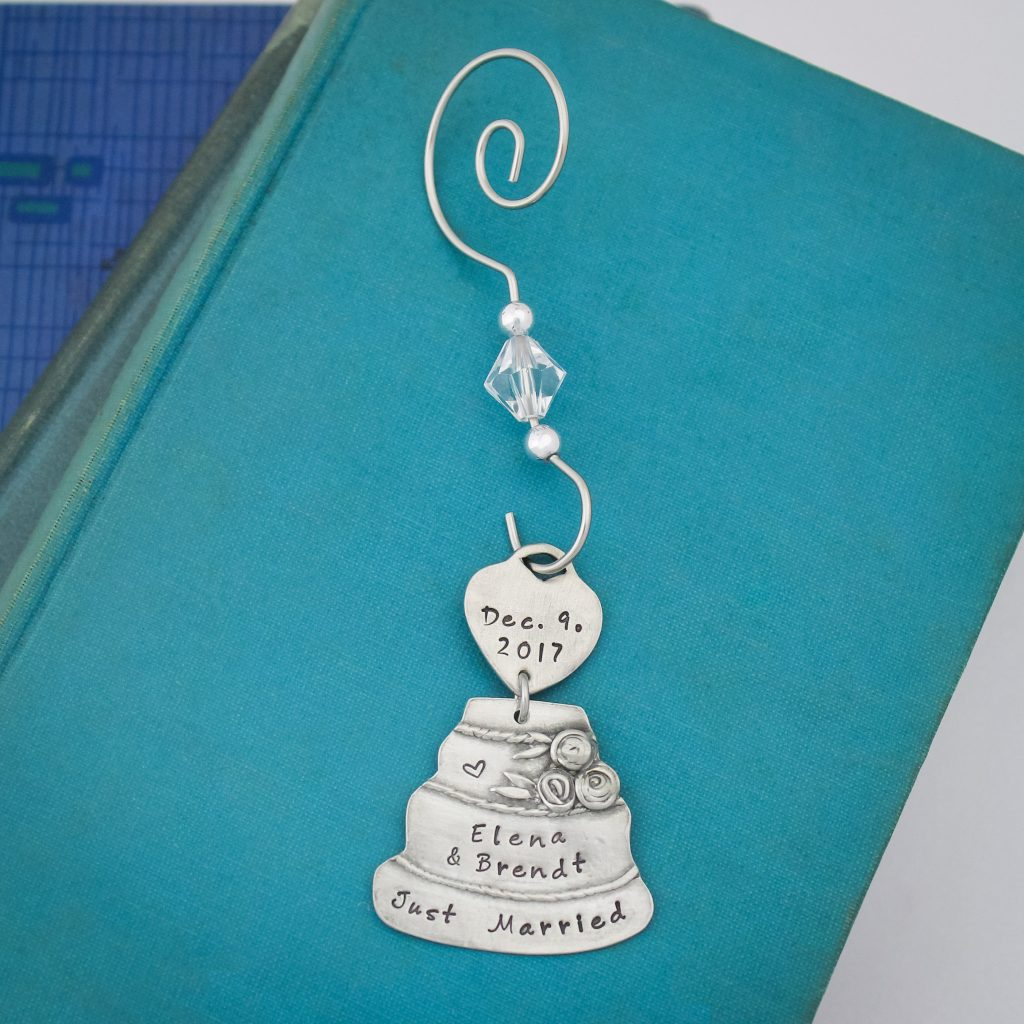 Personalized wedding cake ornament with couples wedding date and names.