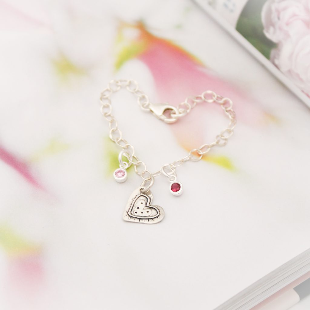 Polka dot silver heart with sterling silver birthstones charm bracelet.