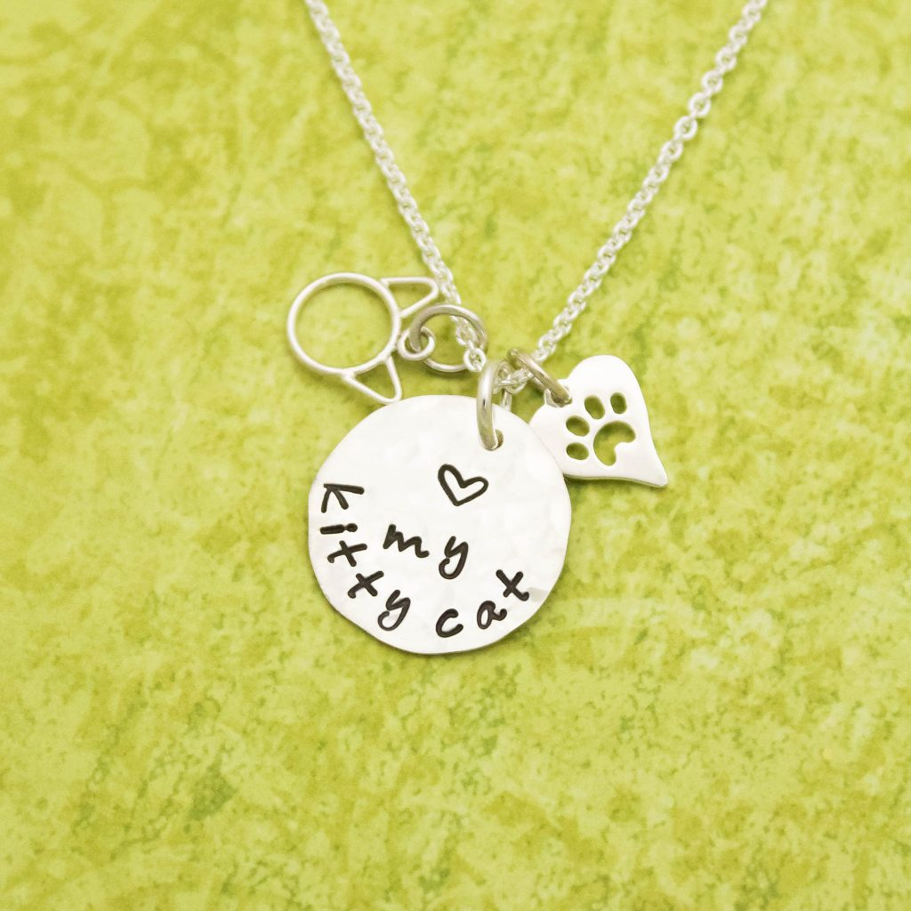 Love my Kitty Cat Necklace in sterling silver.