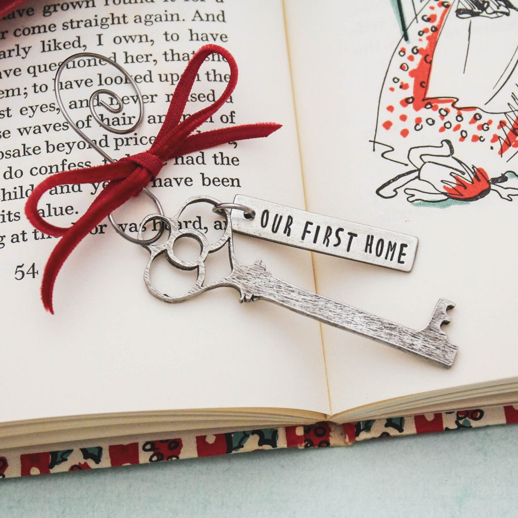 our first home key Christmas ornament in pewter