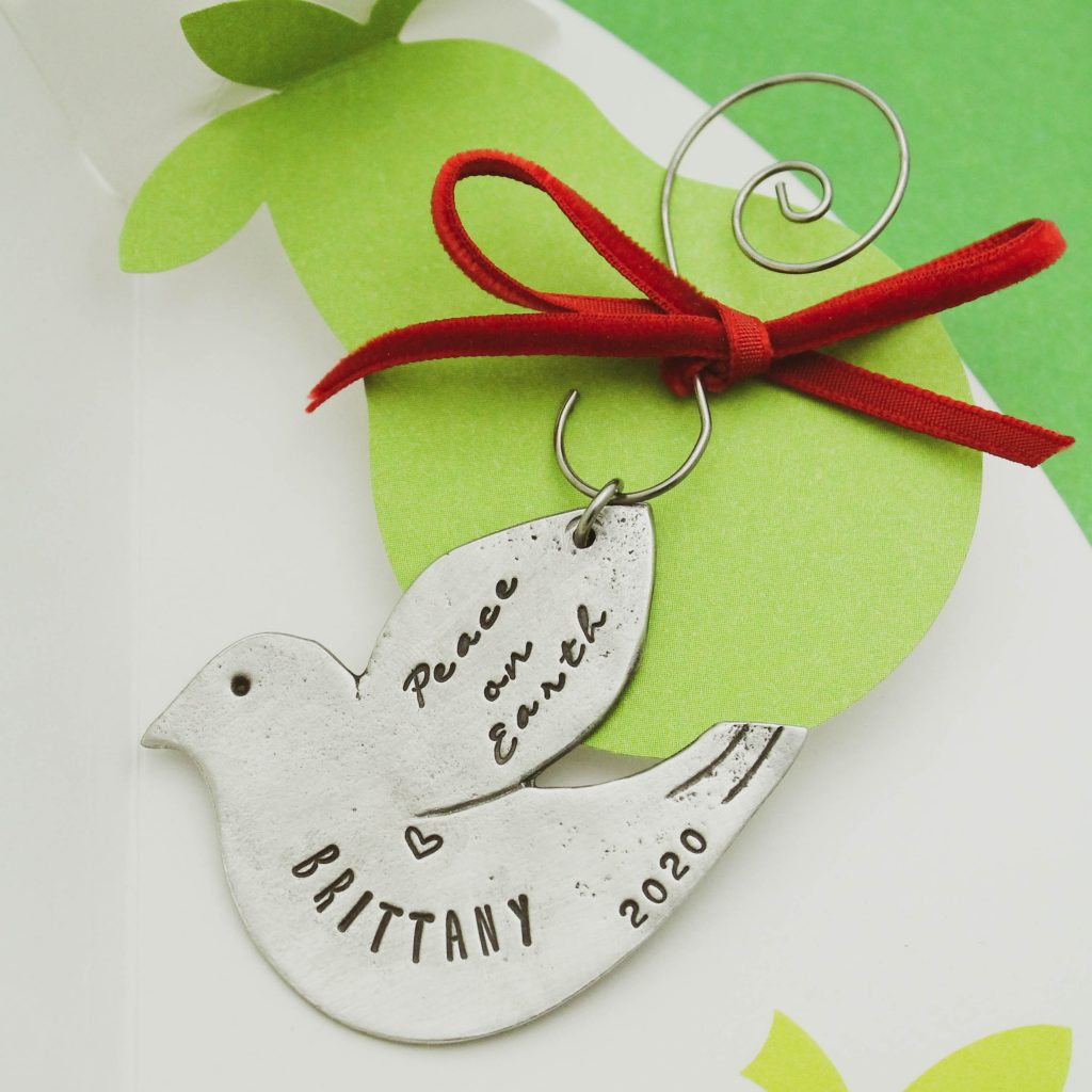 cute dove ornament in pewter peace on earth